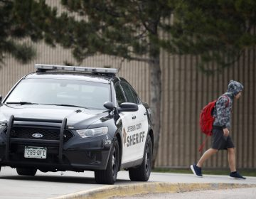 A student leaves Columbine High School late Tuesday, April 16, 2019, in Littleton, Colo. Following a lockdown at Columbine High School and other Denver area schools, authorities say they are looking for a woman suspected of making threats. (David Zalubowski/AP Photo)