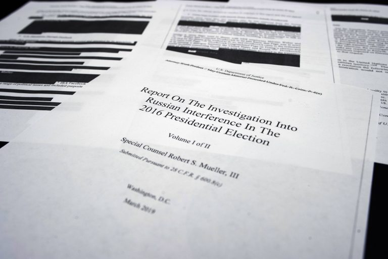 Four pages of special counsel Robert Mueller report on the witness table in the House Intelligence Committee hearing room on Capitol Hill, in Washington, Thursday, April 18, 2019. (Cliff Owen/AP Photo)