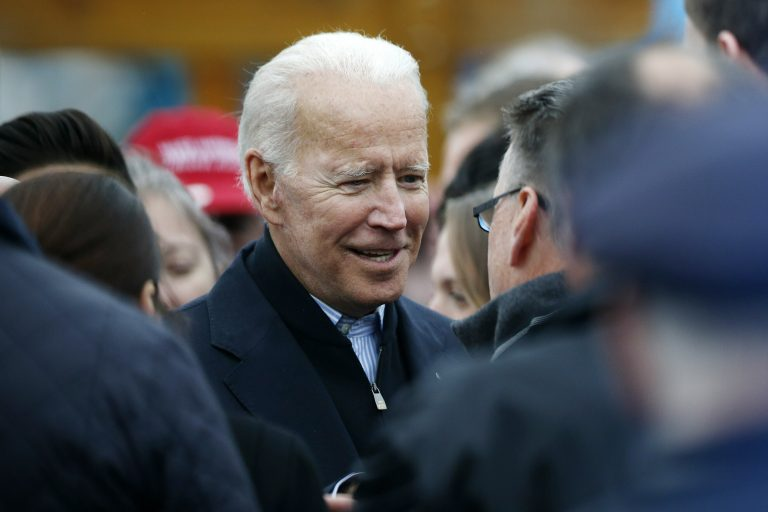 Former vice president Joe Biden talks with officials after speaking at a rally in support of striking Stop & Shop workers in Boston, Thursday, April 18, 2019. (Michael Dwyer/AP Photo)