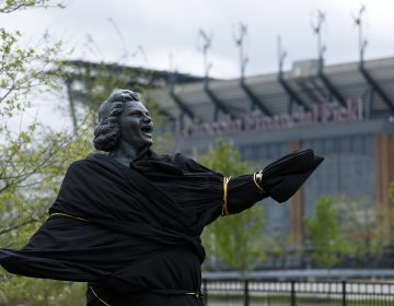 A partially covered statue of singer Kate Smith is seen near the Wells Fargo Center, Friday, April 19, 2019, in Philadelphia. The Philadelphia Flyers covered the statue of singer Kate Smith outside their arena, following the New York Yankees in cutting ties and looking into allegations of racism against the 1930s star with a popular recording of