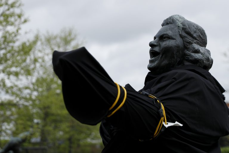 A partially covered statue of singer Kate Smith is seen near the Wells Fargo Center, Friday, April 19, 2019, in Philadelphia. (Matt Slocum/AP Photo)