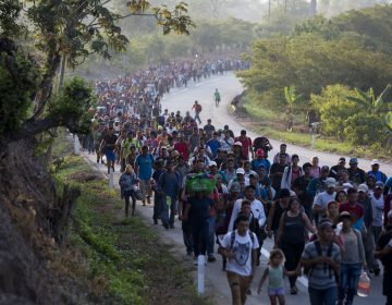 Central American migrants, part of a caravan hoping to reach the U.S. border, move on the road in Escuintla, Chiapas State, Mexico, Saturday, April 20, 2019. Thousands of migrants in several different caravans have been gathering in Chiapas in recent days and weeks. (Moises Castillo/AP Photo)