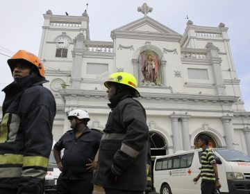 Sri Lankan firefighters stand in the area around St. Anthony's Shrine after a blast in Colombo, Sri Lanka, Sunday, April 21, 2019. Witnesses are reporting two explosions have hit two churches in Sri Lanka on Easter Sunday, causing casualties among worshippers. (Eranga Jayawardena/AP Photo)