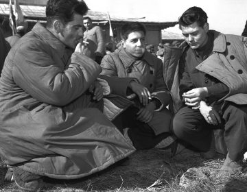In this January 1954 file photo, three Americans who refused repatriation, take a smoke break outside the peace hut at Panmunjom, Korea. They were among 21 U.S. prisoners of war who refused to come home after the Korean War. The new PBS documentary