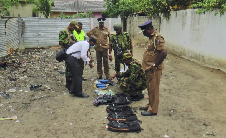 Sri Lankan police and army officers display gelatin sticks, detonators, back packs and other bomb making material recovered from the hide out of militants after Friday's gun battle in Kalmunai, in eastern Sri Lanka Sri Lanka, Saturday, April 27, 2019. Militants linked to Easter suicide bombings opened fire and set off explosives during a raid by Sri Lankan security forces on a house in the country's east, leaving behind 15 bodies, including six children. (Achala Upendra/AP Photo)