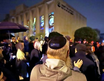 A group gathers outside the Tree of Life Synagogue for a vigil to honor the victims of the Saturday attack on synagogue in California Saturday April 27, 2019 in the Squirrel Hill neighborhood of Pittsburgh. It is six months to the day that a gunman shot and killed 11 people while they worshipped at the Tree of Life Synagogue on Oct. 27, 2018. (AP Photo/Gene J. Puskar)