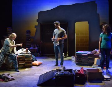 Tim Moyer (left) as the professor, Yousof Sultani as Nazrullah, and Nazli Sarpkaya as Getee in InterAct Theatre Company's production of