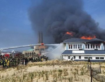Firefighter battle a fire in the Dunes Cafe building on the Ocean Grove boardwalk Saturday afternoon. (Image courtesy of Chris Spiegel/Blur Revision Media Design)