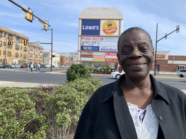 Lucinda Hudson at the site where Starbucks plans to put a new location, a first for the neighborhood. (Aaron Moselle/WHYY)