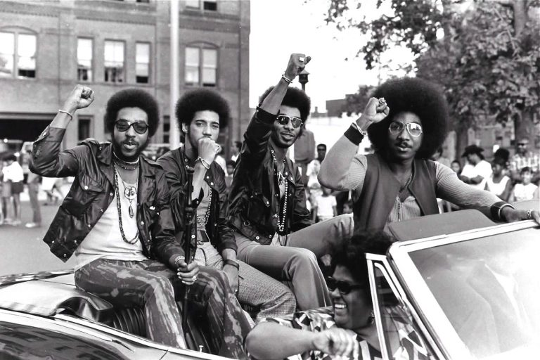 Members of the Nat Turner Rebellion ride in a parade during a Harambe Festival in Springfield, Mass., in the early 1970s. Pictured from left are Major Harris, Ron Hopper, Bill Stratley, and Joe Jefferson. (Courtesy of Reservoir Media)