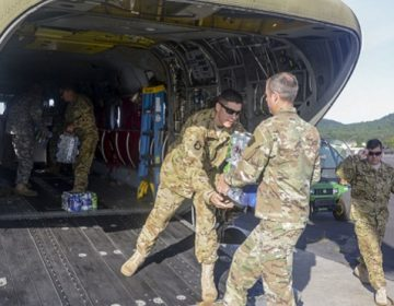 Pennsylvania National Guard Soldiers load bottled water onto a CH-47 Chinook helicopter September 1 at Fort Indiantown Gap in preparation to depart for the Hurricane Harvey relief effort in Texas. (U.S. National Guard photo by Sgt. Zane Craig)