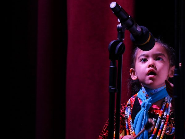 Star Bear Richardson, 4, sings during a performance at We Are the Seeds. (Angela Gervasi for WHYY)