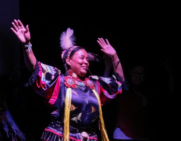 Vaughnda Hilton, founder of the indigenous dance troupe Native Nations Dance Theater, celebrates with audience members during a friendship dance (Angela Gervasi for WHYY)