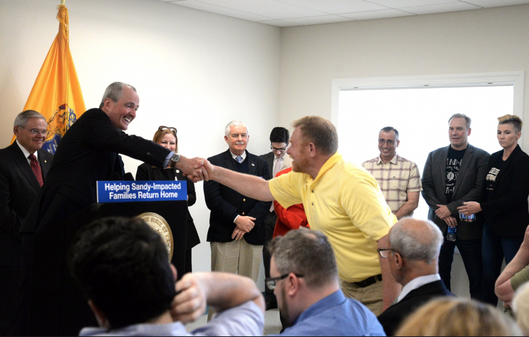 New Jersey Gov. Phil Murphy shakes the hand of a man at a press conference Monday at the Shark River Municipal Marina in Neptune Township. (Image: N.J Office of the Governor)