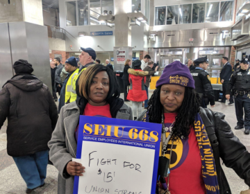 Home healthcare workers Stephanie Williams, left, and Lolita Owens rally at the Frankford Transportation Center in February to pressure state lawmakers to increase the state minimum wage to $15 an hour. (Michael D'Onofrio/Philadelphia Tribune)