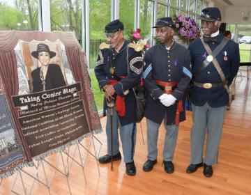 Buffalo Soldiers admire a picture of Audrey Patrick Johnson-Thorton (Abdul R. Sulayman/The Philadelphia Tribune)
