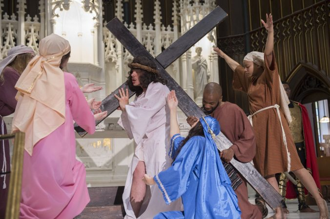 As Jesus falls, Mary and the Weeping Women cry out while Simon, portrayed by Langston Massey-Jefferson, helps to carry the cross. (Jonathan Wilson for WHYY)