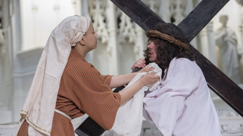 At the Sixth Station of the Cross, Veronica, portrayed by Tonya Mayo, wipes the face of Jesus. (Jonathan Wilson for WHYY)