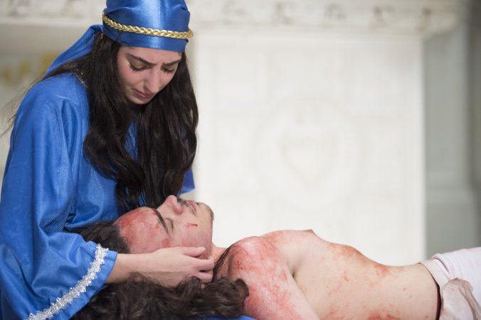 Mary, portrayed by Melanie Ashe, cradles Jesus, portrayed by Marco Newsome, after he is taken down from the cross. (Jonathan Wilson for WHYY)