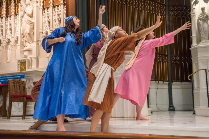 Mary, Veronica, and the Weeping Women reach out to Jesus as he carries the cross. (Jonathan Wilson for WHYY)