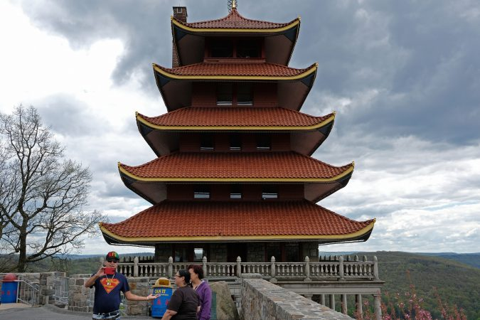 Visitors look out onto the city from Reading's famous Pagoda. (Matt Smith for WHYY)