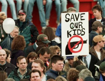 On April 25, 1999, a memorial service for the victims of the Columbine High School shooting Littleton, Colo. (Eric Gay/AP)