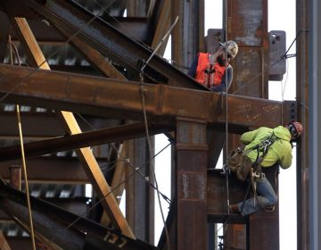 Iron workers help build the Comcast Innovation and Technology Center in Philadelphia. (Matt Rourke/AP Photo)