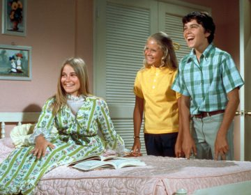 The Brady Bunch, circa 1970, with oldest sister Marcia seated in front. In one episode of the show from 1969, the sisters and brothers all stay home from school with measles. (ABC Photo Archives/Getty Images)