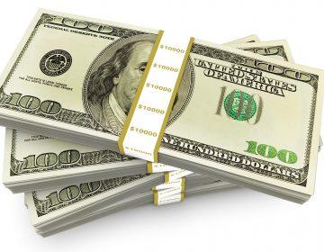 A stack of several bundles of US one hundred dollar bills. (Big Stock)