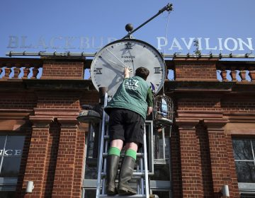 Daylight saving time. ZSL London Zoo trainee keeper Jasmine Sinclair make adjustments to the Bird Clock, created by Tim Hunkin, which stands outside the Blackburn Pavillion at ZSL London Zoo in Regent's Park, London, ahead of this weekends daylight saving time. Picture date: Friday March 29, 2019. See PA story SOCIAL Clock. Photo credit should read: Jonathan Brady/PA Wire URN:42049163 (Press Association via AP Images)