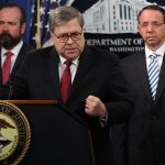 Attorney General William Barr speaks about the release of the redacted version of the Mueller report as U.S. Deputy Attorney General Rod Rosenstein (right) and U.S. Acting Principal Associate Deputy Attorney General Ed O'Callaghan listen at the Department of Justice Thursday in Washington, D.C. (Win McNamee/Getty Images)