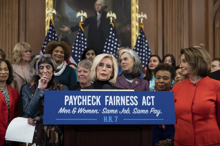Lilly Ledbetter, center, an activist for workplace equality, speaks at an event to advocate for the Paycheck Fairness Act on the 10th anniversary of President Barack Obama signing the Lilly Ledbetter Fair Pay Act, at the Capitol in Washington, Wednesday, Jan. 30, 2019. (AP Photo/J. Scott Applewhite)