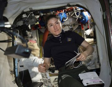 NASA astronaut and Expedition 59 Flight Engineer Christina Koch works on U.S. spacesuits inside the Quest airlock.