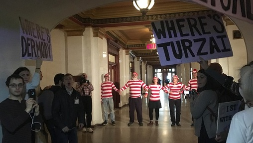 Members of the group March on Harrisburg dressed in Where's Waldo costumes in 2017, after their second march to the Capitol. They were arrested shortly after this demonstration — a common outcome for the group. (Katie Meyer/WITF)