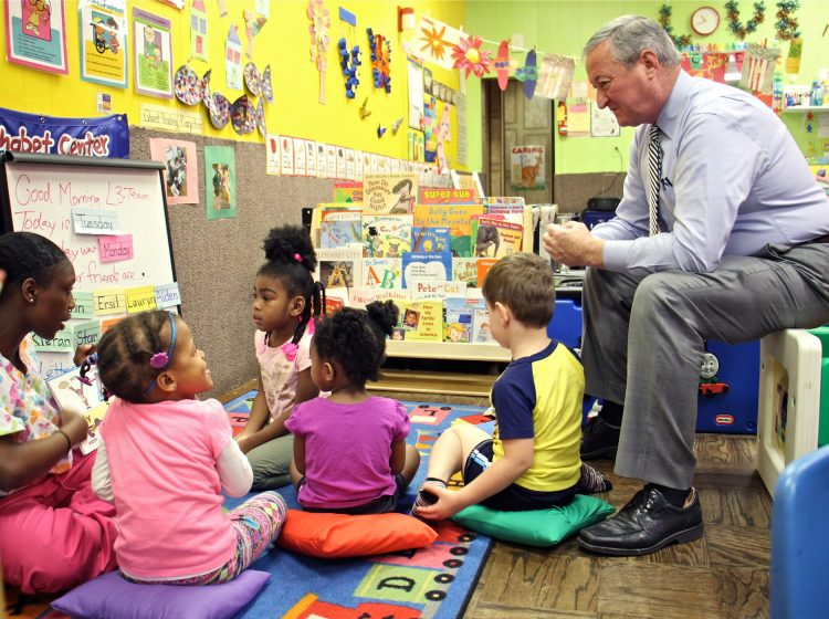 Philadelphia Mayor Jim Kenney sits in on a preschool class at Little Learners Literacy Academy in South Philadelphia in 2016. Pre-K expansion was one of Kenney's top campaign promises. (Emma Lee/WHYY)