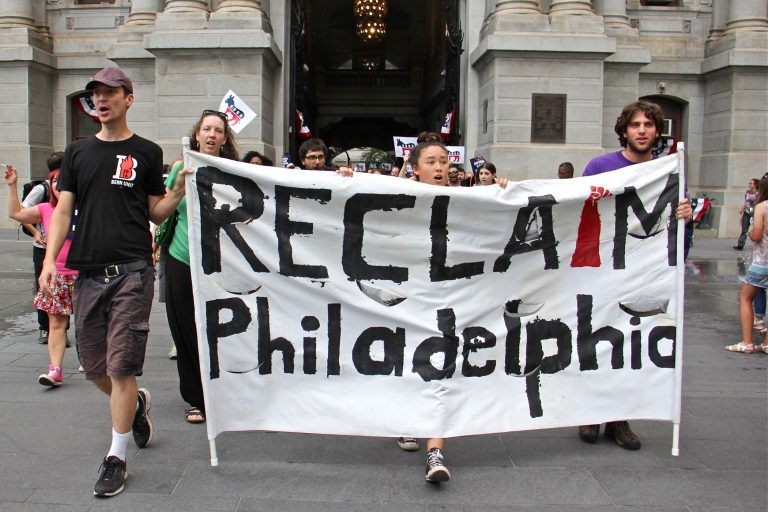 Members of Reclaim Philadelphia march through Center City prior to the Democratic National Convention in 2016 to demand that the DNC reveal its sources of funding.