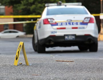 A plainclothes Philadelphia detective shot a panhandler when the man approached the officer's unmarked car. The wounded panhandler's brother says he is developmentally disabled. (Emma Lee/WHYY)