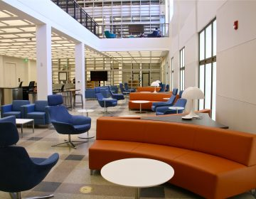 The Business Resource and Innovation Center is below the Heim Center for Cultural and Civic Engagement in the multi-level public space at the Parkway branch of the Free Library of Philadelphia. (Emma Lee/WHYY)