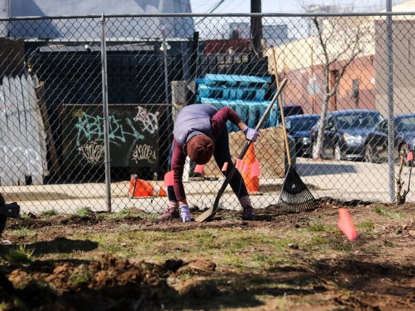 Jessica Noon, a former volunteer for La Finquita, helps prepare a new garden. Noon hopes to create a local land trust that will prevent the closure of any more community gardens. (Angela Gervasi for WHYY)