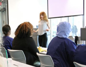 Jennifer O'Toole gives a talk about living with autism to a group of health professionals at Jefferson Health's Navy Yard facility. (Emma Lee/WHYY)