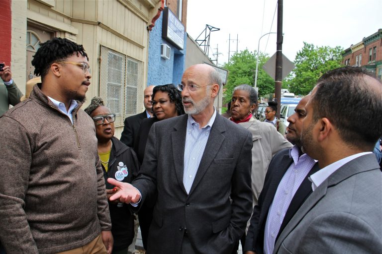 Pennsylvania Gov. Tom Wolf visits Fairhill, one of Philadelphia's poorest neighborhoods, to push for a severance tax on natural gas, which he says could be used to fight urban blight. (Emma Lee/WHYY)