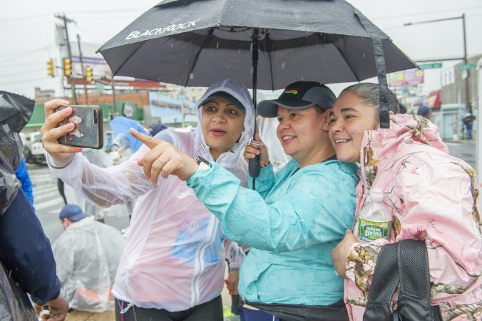 Carmen Hernandez, left, takes a selfie with Lissette Murria and Epi Estremera prior to the Broad Street Run. The women are members of the running group Latinas in Motion. (Jonathan Wilson For WHYY)