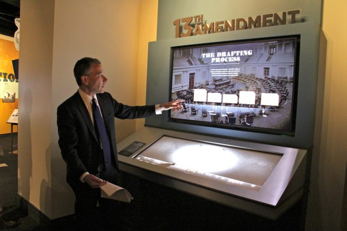 National Constitution Center President Jeffrey Rosen demonstrates one of the interactive exhibits in the center's new show,