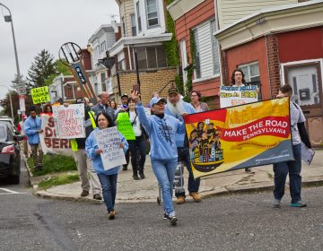 About 30 activists from different organizations marched in solidarity for workers' rights on May Day on Rising Sun Avenue in the lower Northeast section of Philadelphia. (Kimberly Paynter/WHYY)