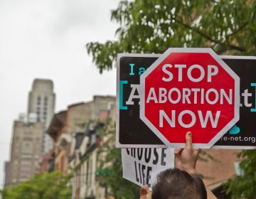 Protestors gathered outside the Planned Parenthood Clinic on Locust Street in Center City Friday morning following a video posted by Representative Brian Sims which showed him berating anti-abortion protestors. (Kimberly Paynter/WHYY)