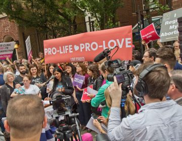 Protestors called for Representative Brian Sims to resign outside the Planned Parenthood Clinic on Locust Street in Center City Friday morning.(Kimberly Paynter/WHYY)