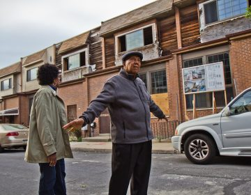 Gerald Renfro and his wife Connie have stayed on the block despite many of their neighbors taking buyouts from the the city and are looking forward to more activity. (Kimberly Paynter/WHYY)