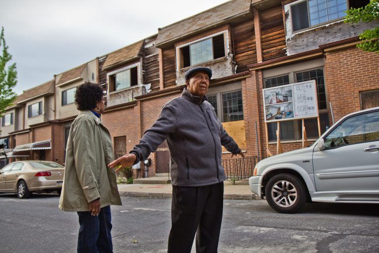 Gerald Renfrow and his wife Connie have stayed on the block despite many of their neighbors taking buyouts from the the city and are looking forward to more activity. (Kimberly Paynter/WHYY)