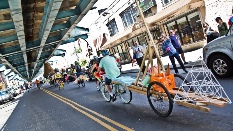 The 2019 Kensington Kinetic Sculpture Derby rides up Front Street. (Kimberly Paynter/WHYY)