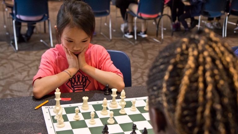 Sharon Suardi, 8, contemplates her next move at the ASAP Philly Girls Play Chess tournament. (Kimberly Paynter/WHYY)